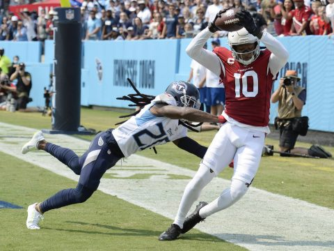 Arizona Cardinals wide receiver DeAndre Hopkins (10) catches a touchdown pass as he is defended ...
