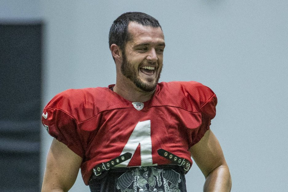 Raiders quarterback Derek Carr (4) laughs with teammates during practice at the Intermountain H ...
