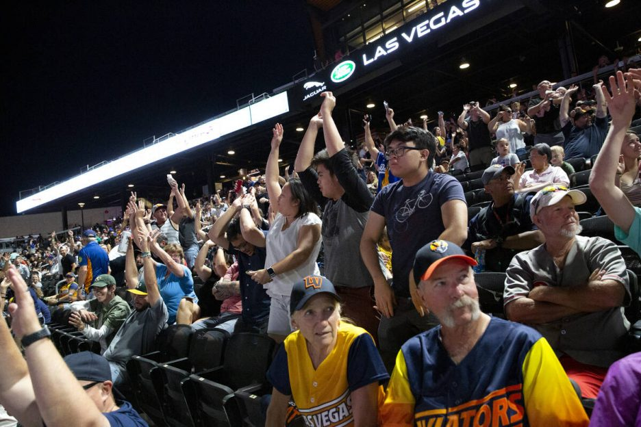Aviators fans do the wave during a minor league baseball game against the Reno Aces at Las Vega ...