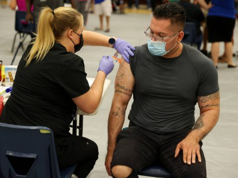Steve Cancino of Las Vegas, right, receives his second dose of the Moderna COVID-19 vaccine fro ...