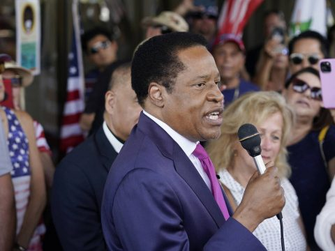 In this July 13, 2021, file photo, conservative radio talk show host Larry Elder speaks to supp ...