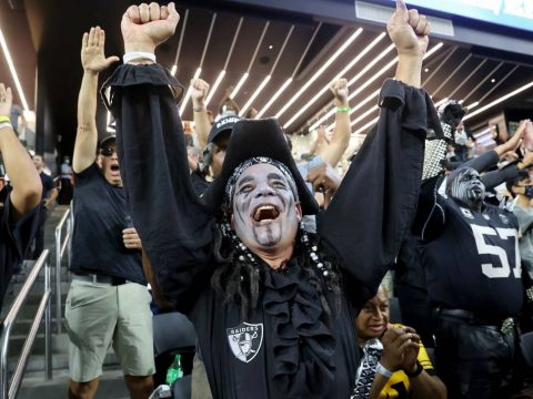 Raiders fans celebrate their overtime win in the season-opener against the Baltimore Ravens at ...
