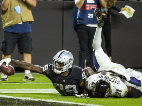 Raiders wide receiver Bryan Edwards (89) extends for a near score with Baltimore Ravens cornerb ...