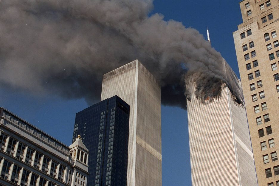 Smoke pours from one of the towers of the World Trade Center Tuesday, September 11, 2001, after ...
